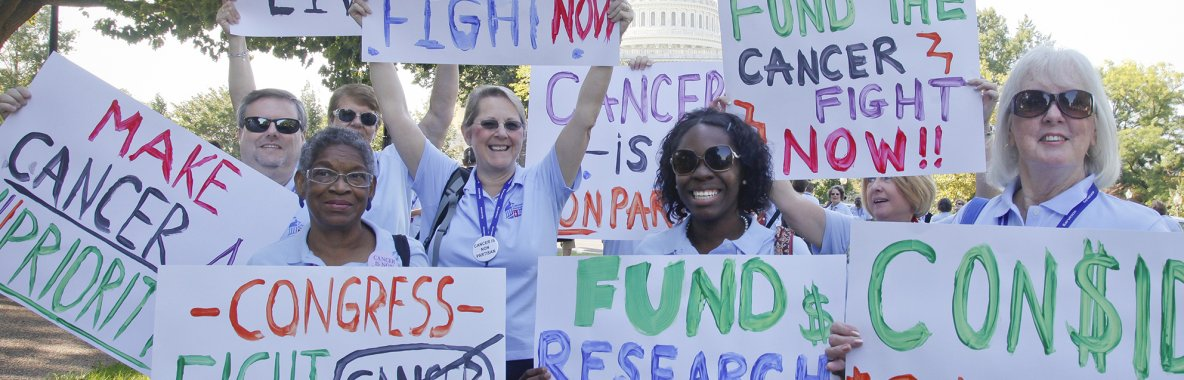 Volunteers holding signs at advocacy rally